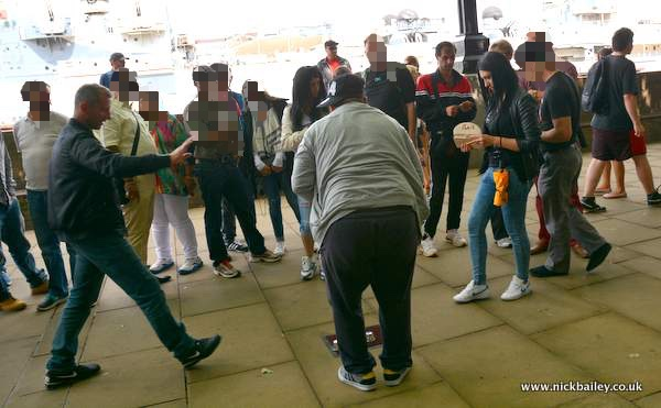 Dodgy cup game on London Southbank. © Nick Bailey